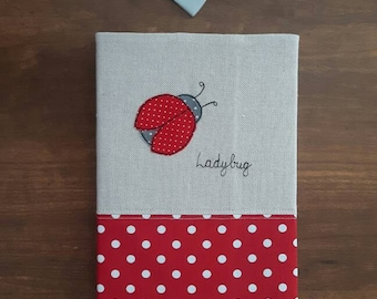 A5 fabric covered notebook / journal/diary/planner cover using free motion embroidery with Ladybug applique, diary, sketchbook