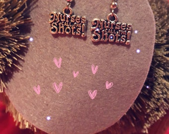 "Cute ""Nurses call the shots"" earrings"