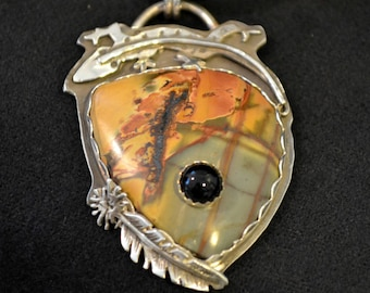 Southwestern lizard and stone on stone pendant.