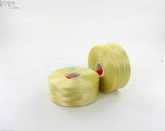 1 spool of thread CLON - color: cream-clear C LON (Nymo) size D CLON11