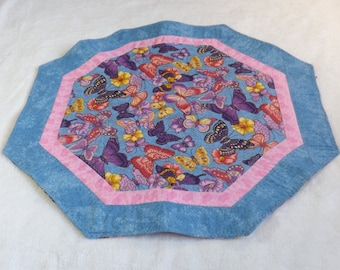 octagon table runner / center piece made from pink, purple, and yellow butterflies on blue with coordinating pink and blue  farbic