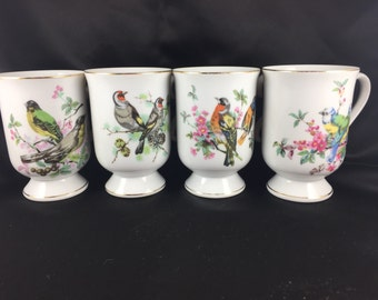 4 fancy Bird mugs.