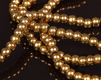 1 row of 70 Gold 4mm electroplate glass beads