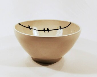 A 'Bird On A Wire' ceramic breakfast/serving bowl.