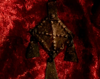 Fully intact, primitive bronze pendant