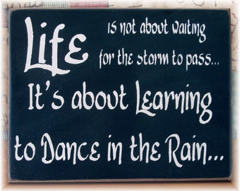 Life is not about waiting for the storm to pass it's about learning to dance in the rain sign