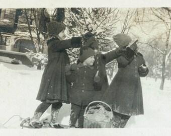 Vintage photo Children on Sled Point toward Sky