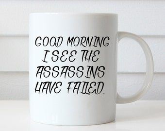 Funny Coffee Mug, I see the assassins have failed, Typography Coffee Mug Gift for Her Him Coffee Lover Gift Birthday Gift Christmas Gift