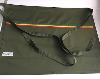 Khaki waist apron with 3 large pockets.
