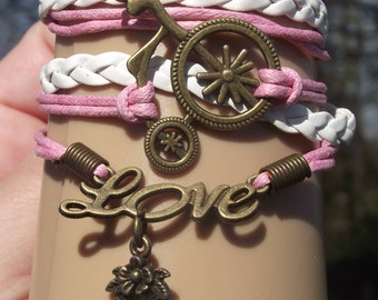 Charm heart Love bicycle, an Extension chain and clasp. Multicolor.
