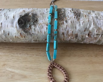 Cowgirl style wrapped reed oval pendant necklace on a soft blue turquoise howlite necklace with shell heishi accents