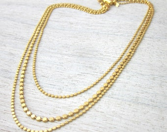 Disc Elegance Necklace in Gold, layered bib jewelry