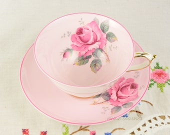 Pink rose Paragon tea cup and saucer, double warrant