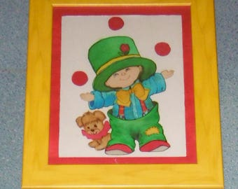 LITTLE CLOWN in painting on silk in a yellow wood frame