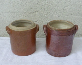 Set of two brown varnished gres pots, ideal as cache pot for planting aromatic plants in the kitchen