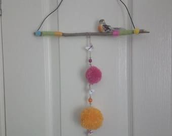 Beautiful bird on a wire wall hanging to brighten up any space.