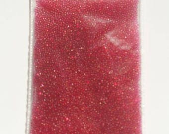 Bag of 10 grams of micro beads neon Red