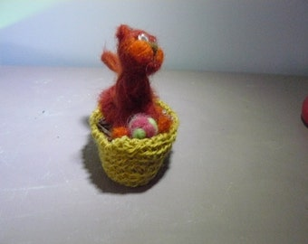 kitten in his basket