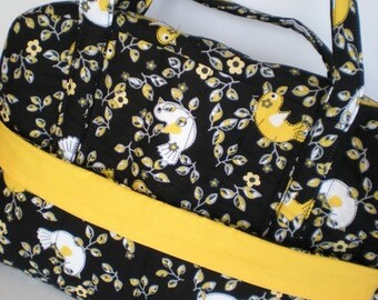 CLOSEOUT - Spacious Black and Yellow Bird Quilted Shoulder Bag Loaded with Pockets
