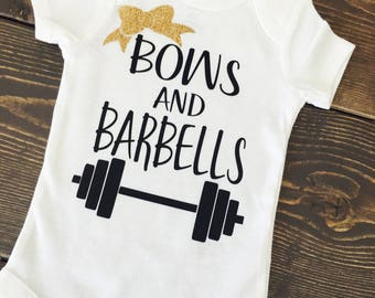 Bows and barbells. Baby workout. Baby lifting. Daddys lifting budding. Mamas lifting buddy. Workout baby.