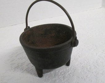Vintage  Rustic Cast iron footed cauldron used fair condition some rust inside