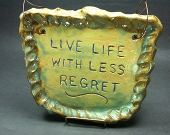 """Wall Decor """"Live Life With Less Regret"""" - Creamy White Stoneware Clay Handmade Tile in Greens & Golds/Brown Thumb Impressed Clay Surrounds"""