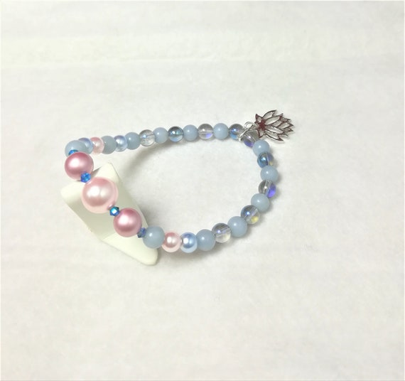 wedding bracelet with pearly swarovski beads, semi-precious blue stones and a silver  plated stylised lotus flower