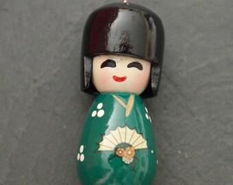 Green wooden Chinese Japanese Kokeshi doll