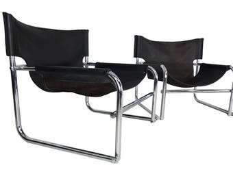 Vintage Mid Century leather sling chairs by Rodney Kinsman for OMK