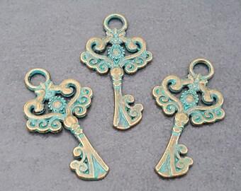 3 charms key metal blue/bronze 33 x 18 mm