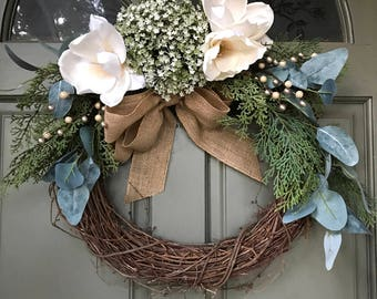 Holiday Christmas Wreath w/ magnolia and greenery, frosted flowers, pine cones and metallic berries, burlap bow