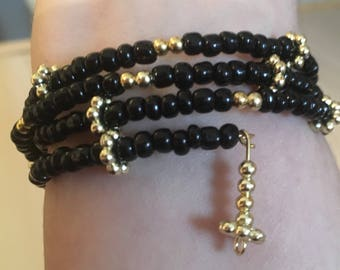 Beautiful black and gold wrap bracelet with dangle