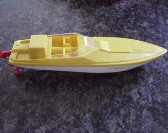 Toy wind up boat from the Arco Company, 1970's
