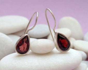 Handmade ethnic silver and garnet earrings. Garnet and sterling silver ethnic earrings.