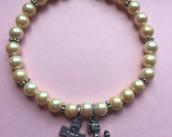Girls Holy Communion charm bracelet pearl with spacers. Fits 6 1/2 inch wrist comes with gift box.