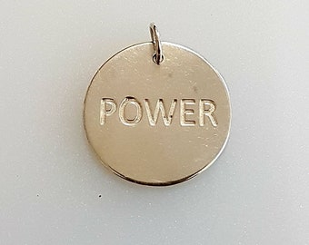 Power disc on necklace