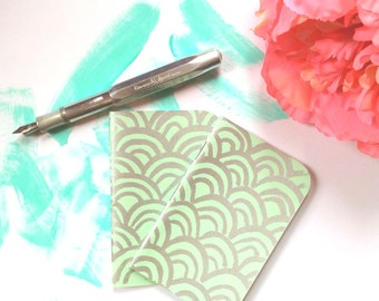 tiny mint green notebook, screen printed in silver ink, filled with Tomoe River paper