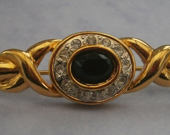 B962) A lovely gold tone metal vintage diamante and black cut glass bar brooch