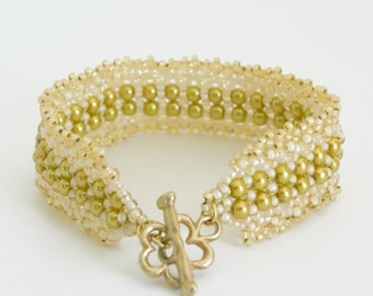 Beaded Bracelet with Gold Glass Pearls and Cream Beads with Semi Matte Gold Plated Flower Shaped Clasp. S112