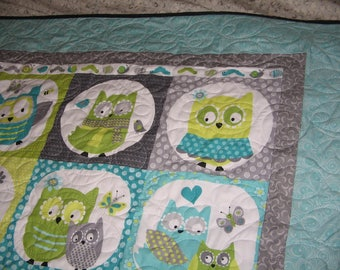 """42X52"""" Panel of Owls in bright cheery grey prints and turquoise prints and borders. Great Kids Quilt."""