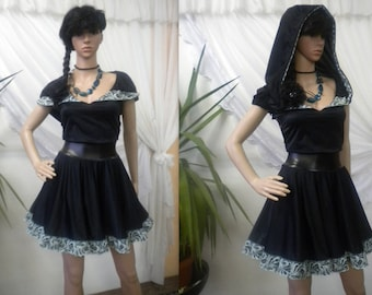 Elegant and unusual black dress of polyamide with turquoise lace