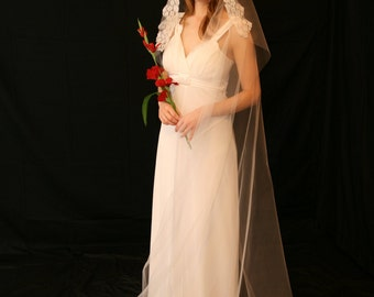 Floor length veil with lace framing face