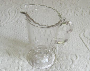 vintage glass creamer . glass creamer . footed glass creamer . small glass pitcher