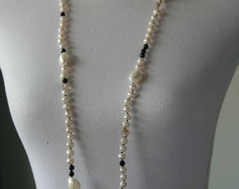 Long necklace, with black silk knotted white fresh water pearls, onyx and Crystal, with gold plated lobster clasp