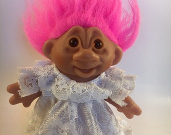 1986 DAM Troll doll with white dress and hit pink hair