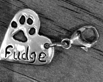 Silver hand crafted paw print charm
