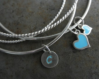 Set of 4 sterling  bangle bracelets with enamel charms