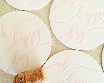 Set of eight blush pink Oh Happy Day letterpress coasters