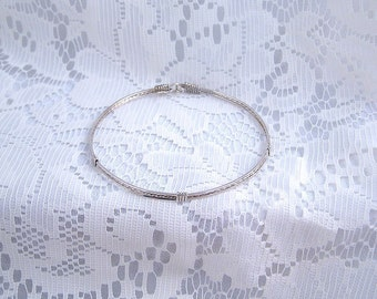 Simple sterling silver bangle wire wrapped bracelet