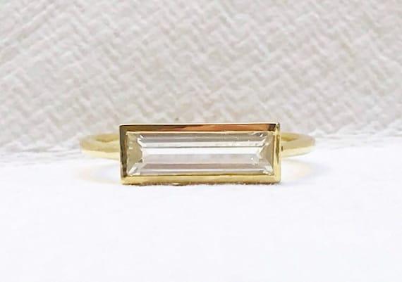 Nigerian phenakite horizon ring in solid 18k gold